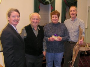 Media Council Pres. Frank Daly & Hal Taussig with Fair Trade raffle winners Kate & Gary White, who won a 2 wk. Swiss Untour